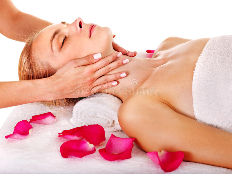 Woman getting facial massage . Woman getting facial massage in beauty spa. Isolated royalty free stock photo