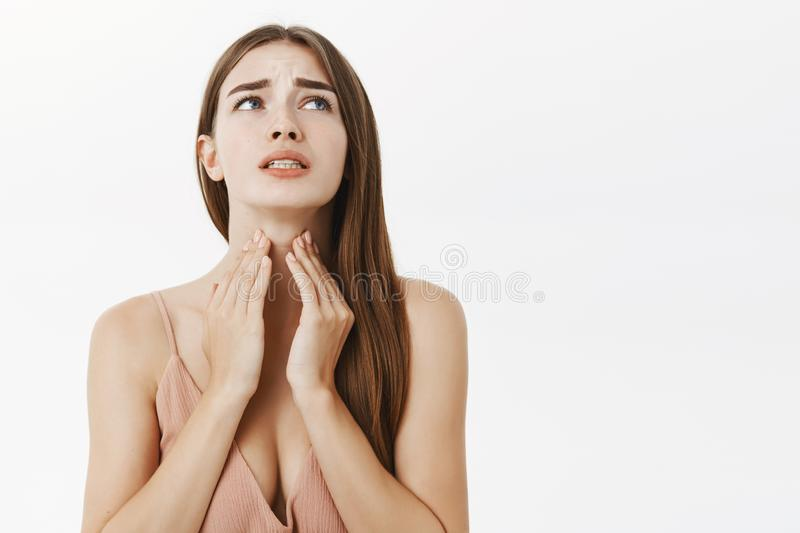 Woman getting ill before important meeting feeling discomfort and suffering from pain in throat touching neck frowning royalty free stock photography