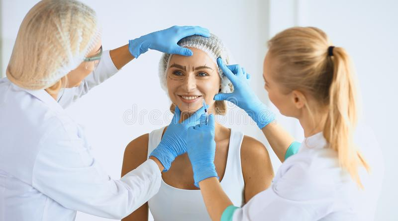 Woman getting injection. beauty injections and cosmetology.  royalty free stock images