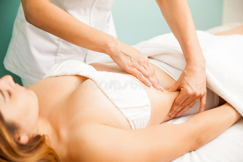 Woman getting a lymphatic massage royalty free stock image