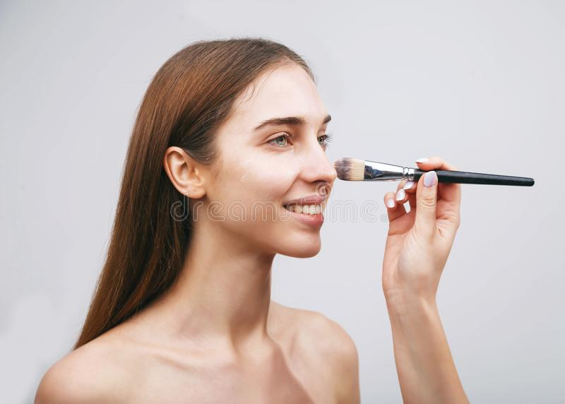 Woman Getting Makeup royalty free stock photos