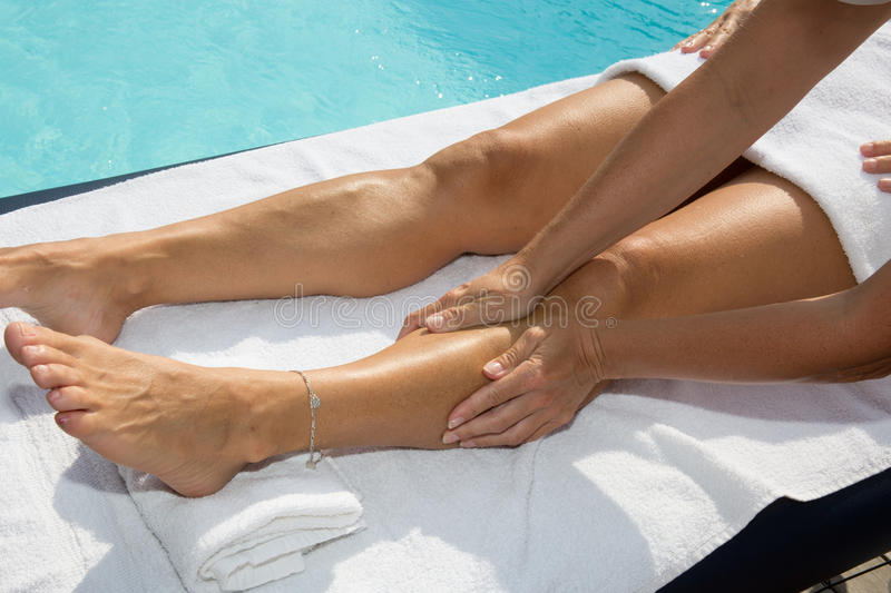 Woman getting a massage treatment at spa center stock photo
