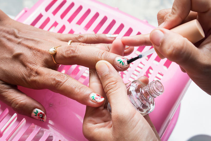 Woman getting nail manicure royalty free stock photography