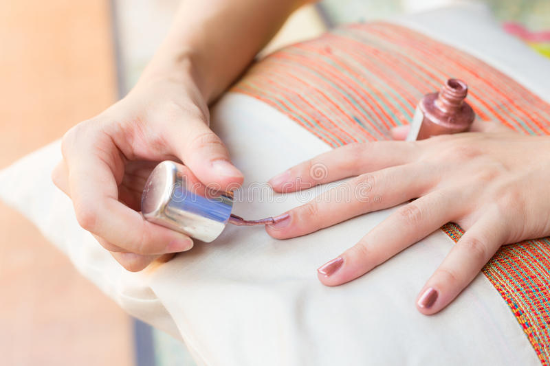Woman getting nail manicure paint on hands. royalty free stock photo