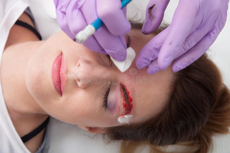 A woman getting permanent make up stock photo