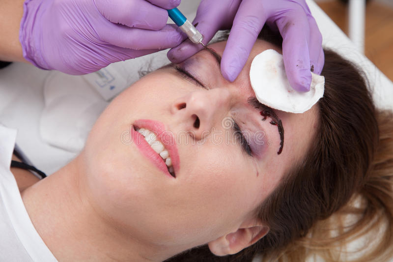 A woman getting permanent make up royalty free stock photo