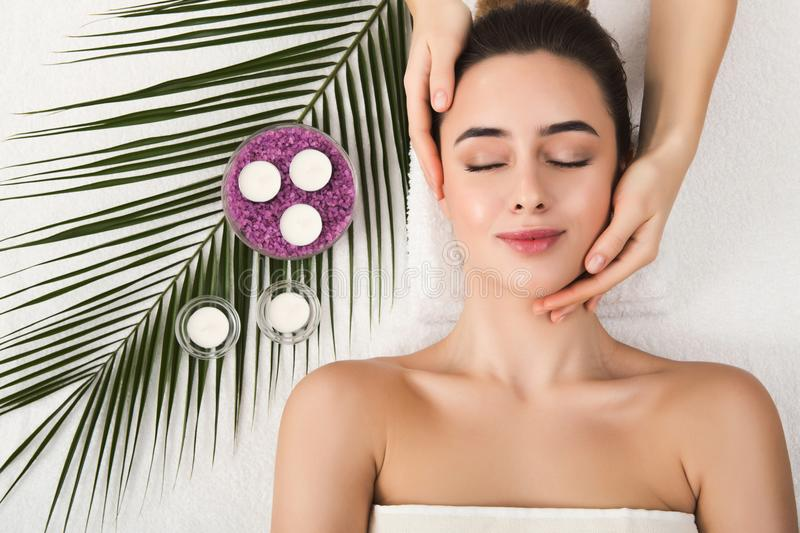 Woman getting professional facial massage at spa salon royalty free stock photos