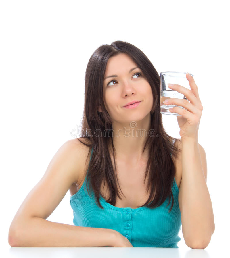 Woman getting ready to drink glass of drinking water. stock image