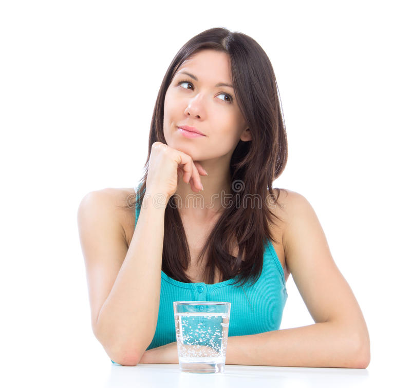 Woman getting ready to drink glass of water stock images
