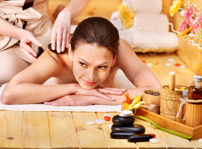 Download Woman Getting Stone Therapy Massage . Stock Image - Image: 24459361