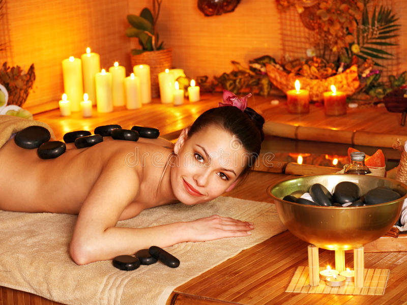 Download Woman Getting Stone Therapy Massage . Stock Photography - Image: 24459442