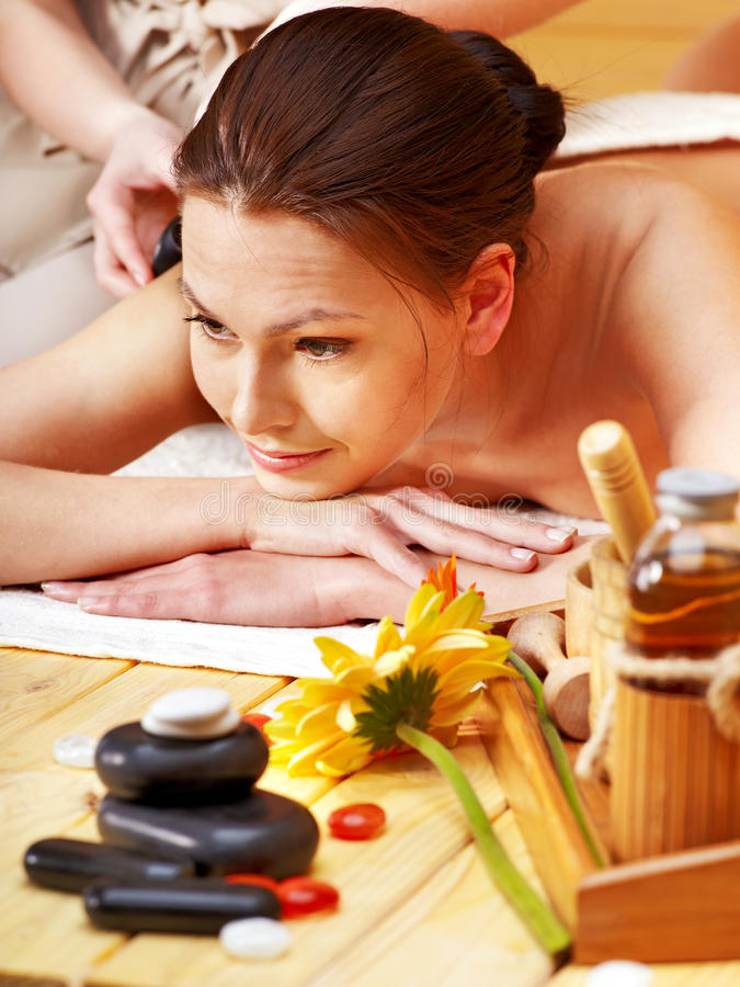 Download Woman Getting Stone Therapy Massage . Stock Image - Image: 25078393