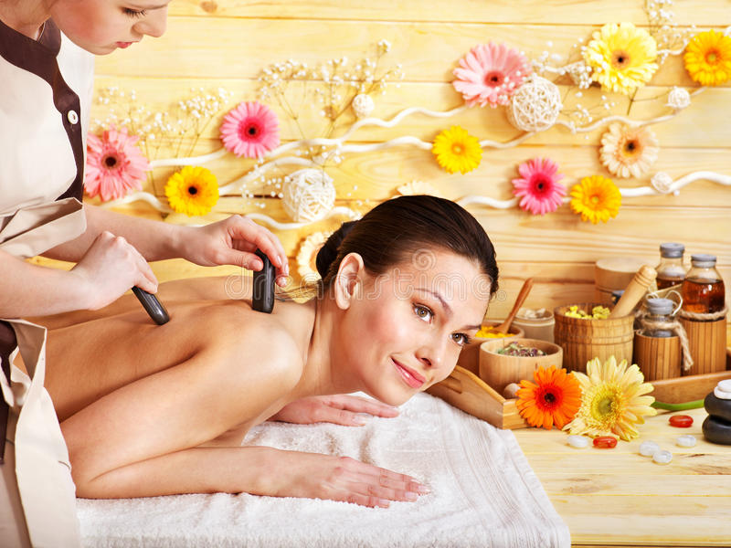 Download Woman Getting Stone Therapy Massage . Stock Image - Image: 27184313