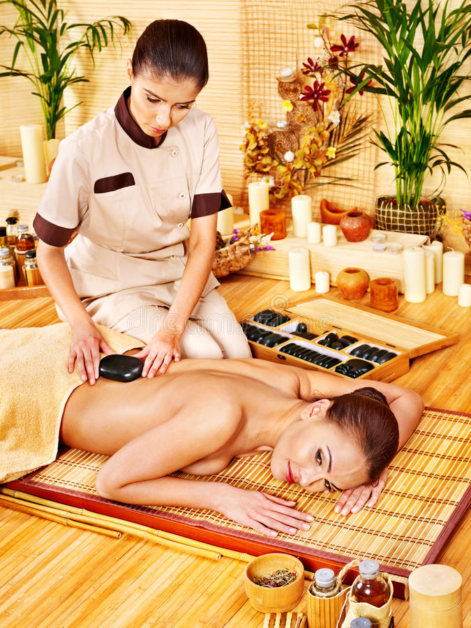 Download Woman Getting Stone Therapy Massage . Royalty Free Stock Photography - Image: 27442327