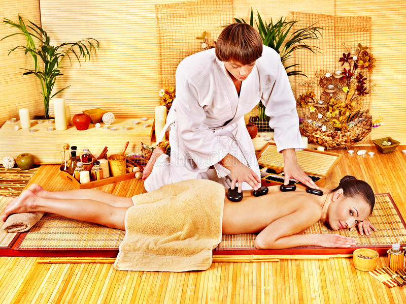 Download Woman Getting Stone Therapy Massage . Stock Image - Image: 28880699