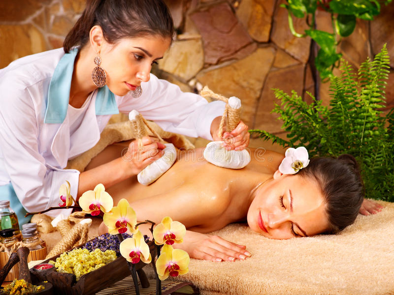 Woman getting thai herbal compress massage . royalty free stock photos
