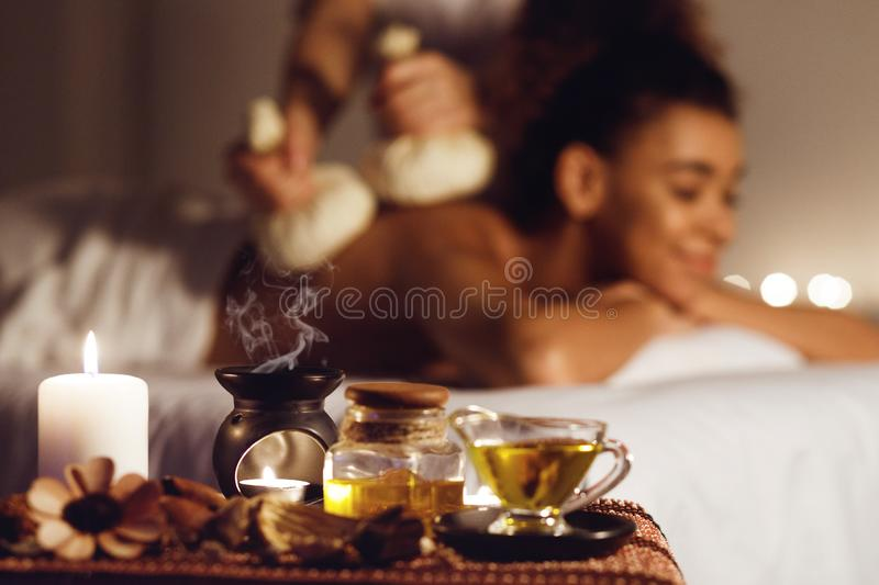 Woman getting thai herbal compress massage in spa stock photo