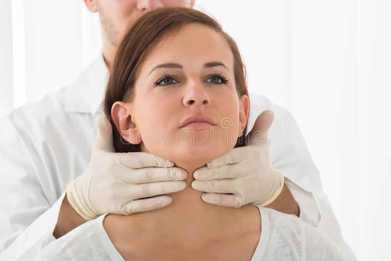 Woman Getting Thyroid Gland Control. A Doctor Performing Physical Exam Palpation Of The Thyroid Gland royalty free stock photography