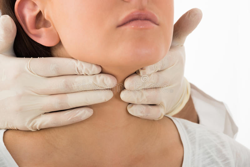 Woman Getting Thyroid Gland Control. A Doctor Performing Physical Exam Palpation Of The Thyroid Gland royalty free stock photos