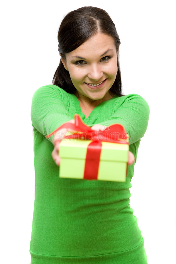 Woman with gift. Attractive brunette woman with gift on white background stock images