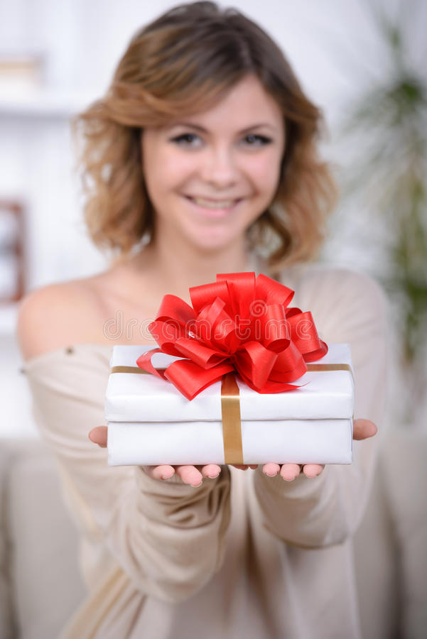 Woman with gift. Portrait of cute girl receive gift box, enjoying present at home, romantic relationship, Valentine day, love and happiness concept stock images
