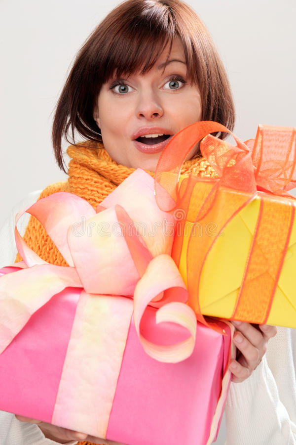 Woman with gifts royalty free stock photos