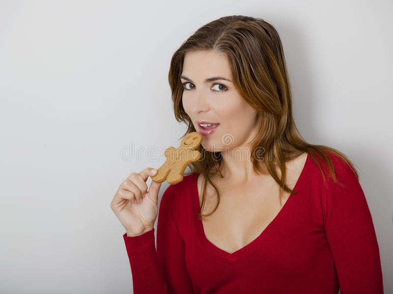 Download Woman With A Gingerbread Cookie Stock Image - Image: 22021071