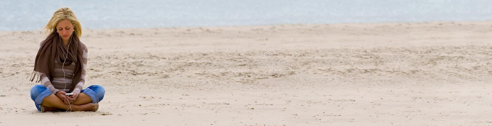 Woman Girl on Beach Listening to Music on Smart Phone stock photos