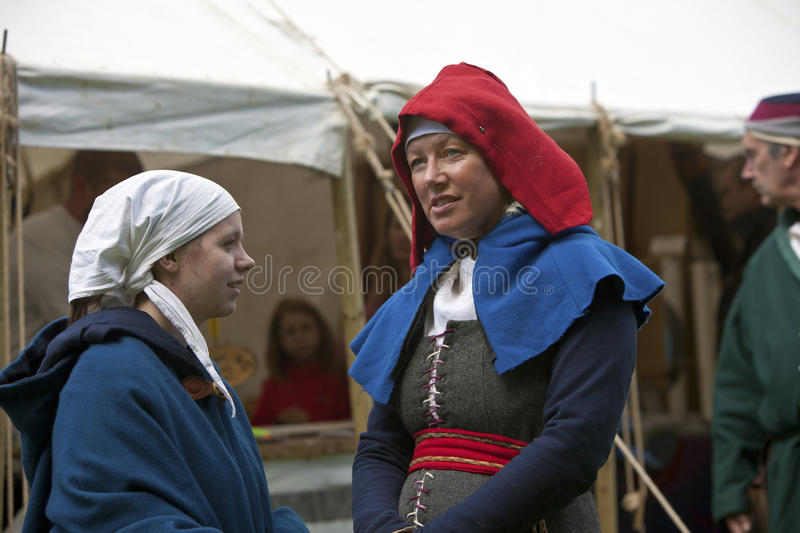 Woman And A Girl In Medieval Costume Talking. Editorial Stock Image