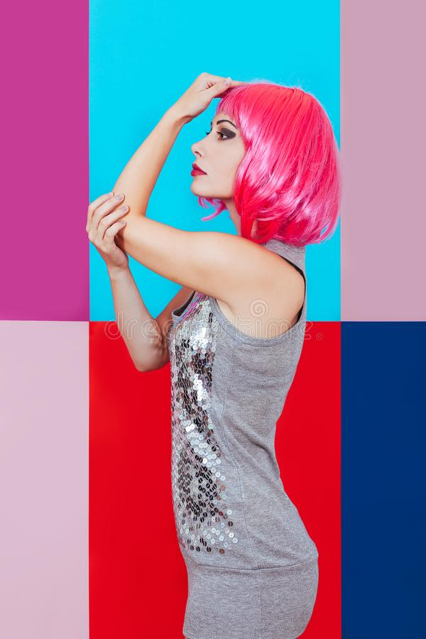 Woman girl pink hair silver dress background multicolored graphic red blue portrait beauty tenderness disco stock photo