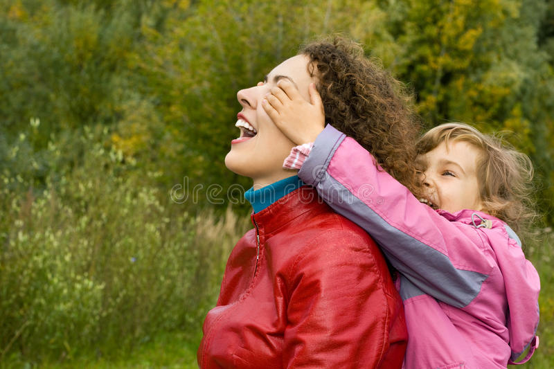 Download Woman And Girl Playing In Garden, Girl Closes Eyes Stock Image - Image: 11603633