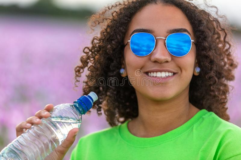 Woman Girl Teenager Field of Flowers Wearing Sunglasses Drinking Water Bottle stock images