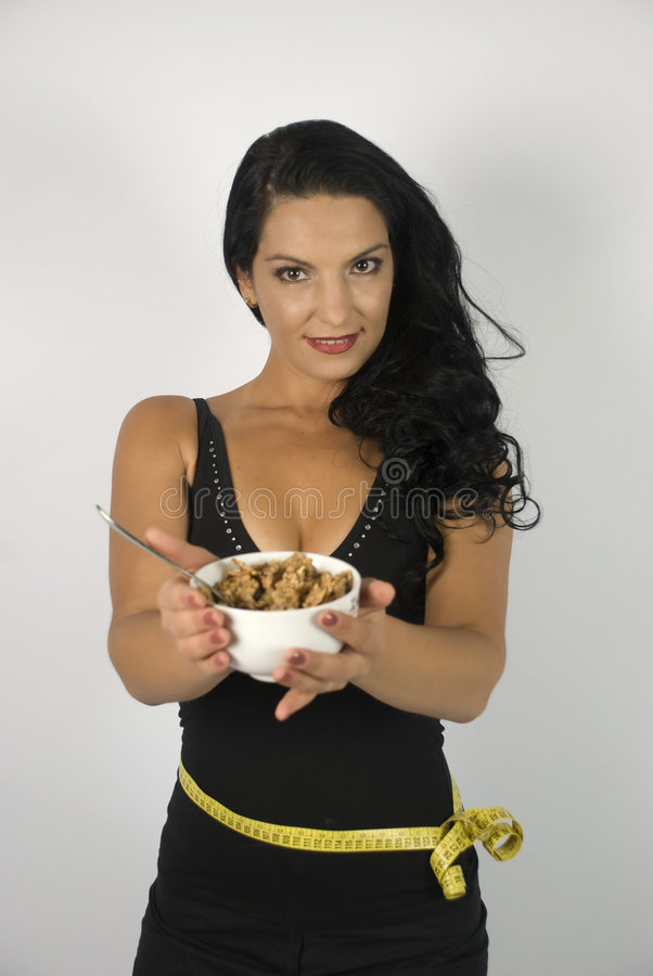 Woman giving bowl with cereals stock photography