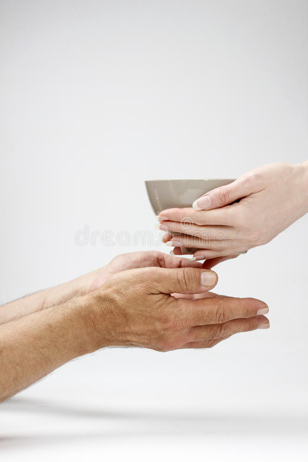 Woman giving bowl od hot meal to the hungry man royalty free stock images