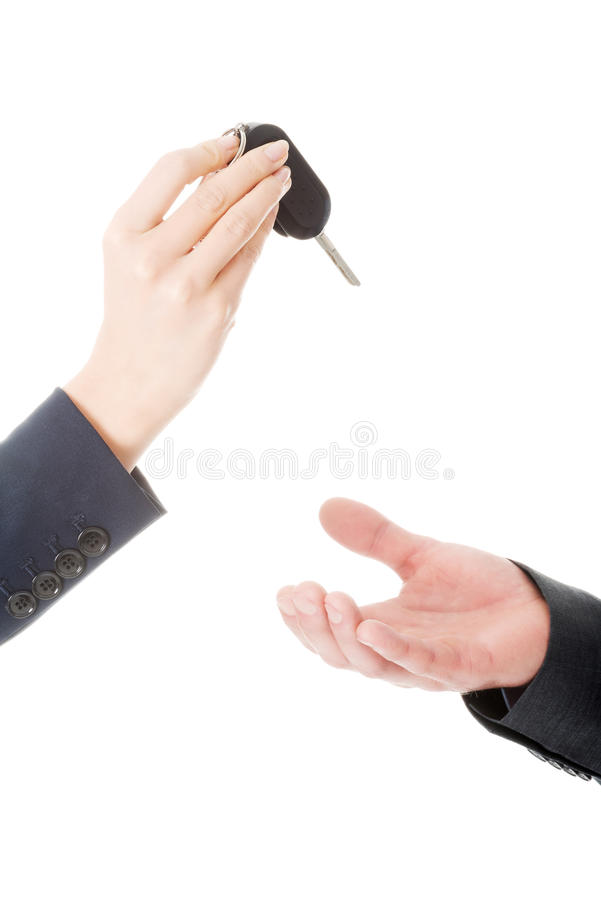 Woman giving car keys to the man. Businesswoman giving car keys to the man stock photo