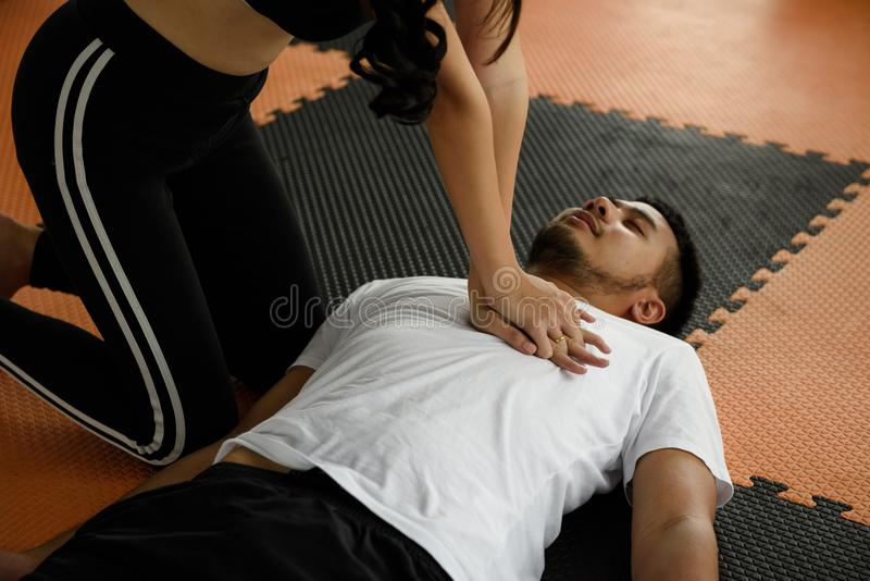 Woman giving cpr to drowning man stock photo