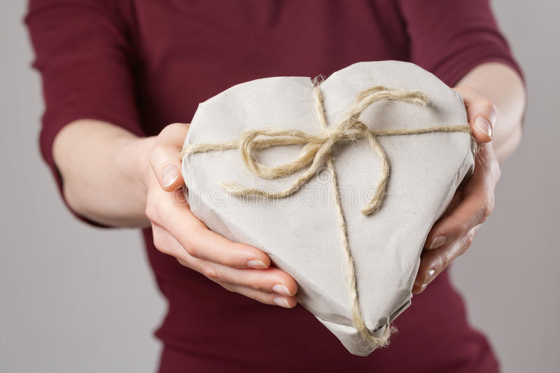Woman Giving a Heart Shaped Gift royalty free stock photos