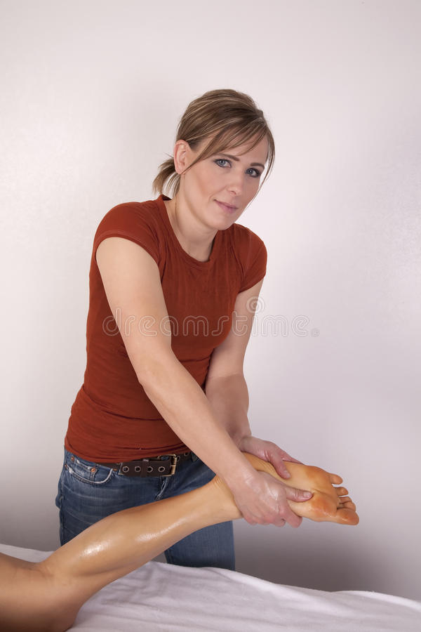 Download Woman Giving Massage On Foot Stock Photo - Image: 12942808