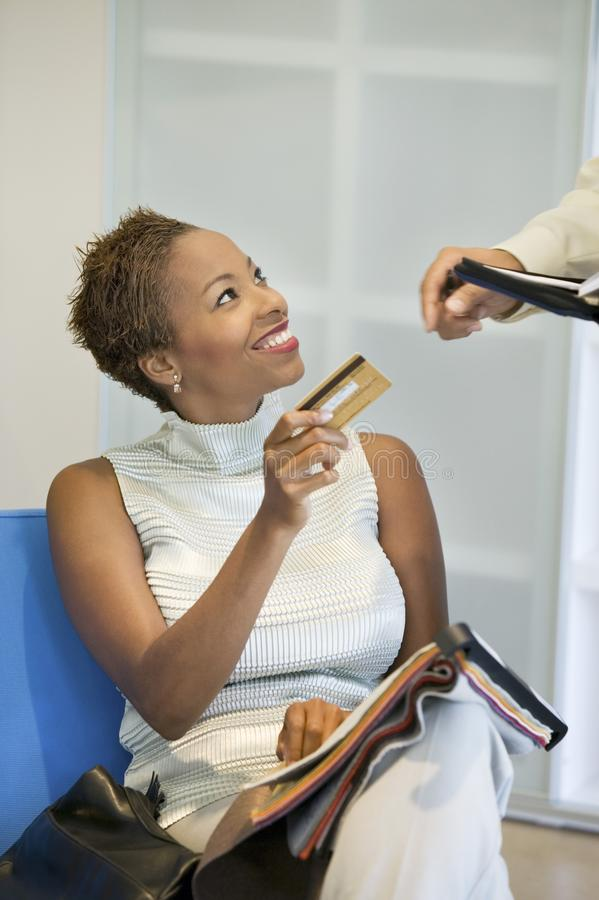 Woman giving partner Credit Card royalty free stock photography