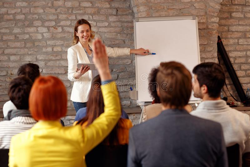 Woman giving presentation on the chart on the seminar. For student royalty free stock photo