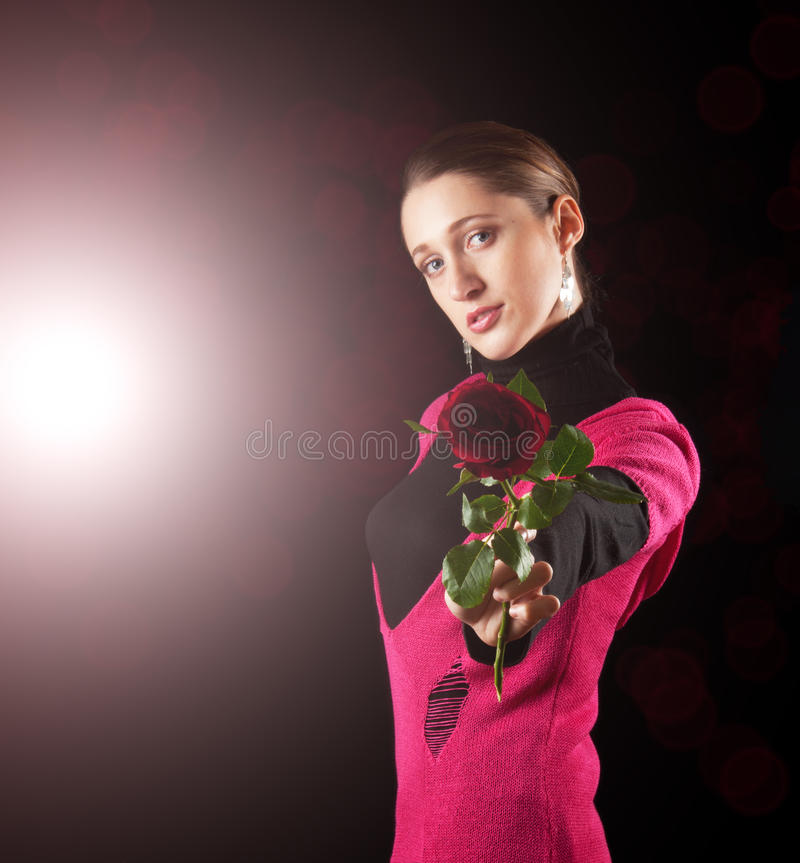 Woman giving red rose stock photo