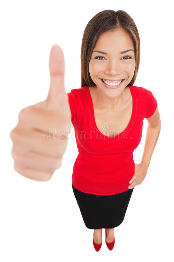 Woman giving thumbs up approval hand sign gesture. Smiling happy isolated on white background in full body length in high angle perspective view. Content smile royalty free stock images