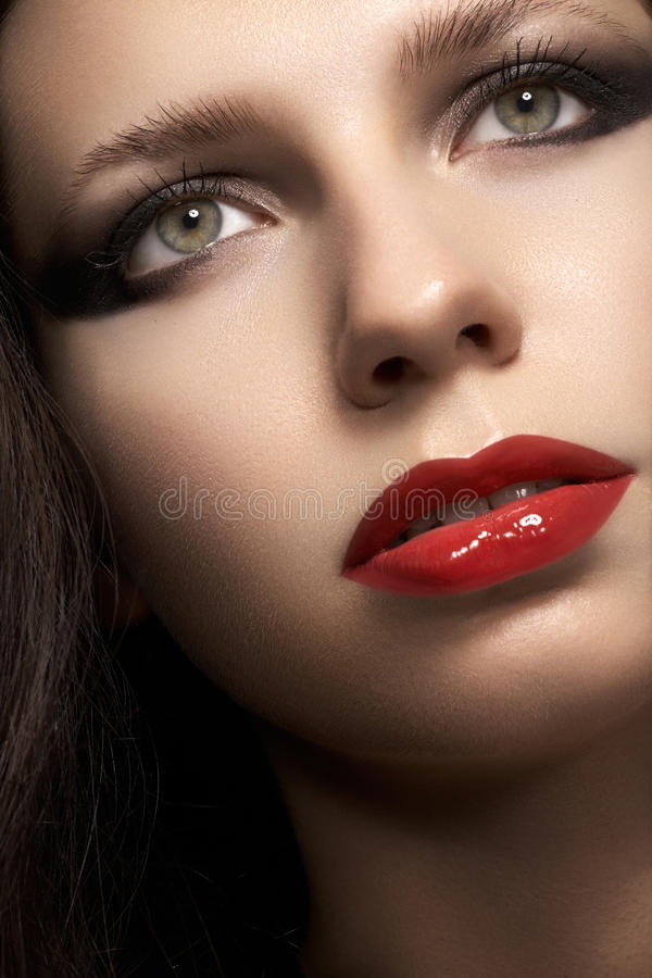 Woman with glamour red lips make-up, eye arrow makeup, purity complexion stock photos