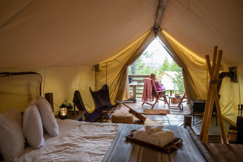 Woman glamping in forest stock image