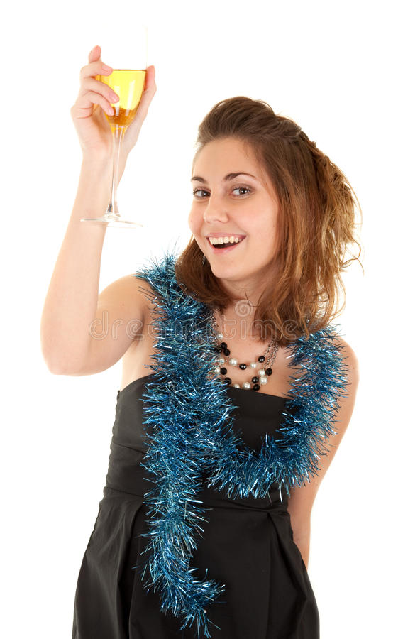 Woman with a glass of champagne. Beautiful woman with a glass of champagne on white background. Focus on woman's eyes royalty free stock photo