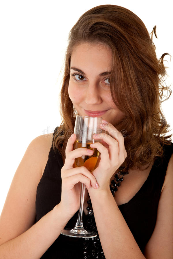 Woman with a glass of champagne. Beautiful woman with a glass of champagne on white background. Focus on woman's eyes stock images