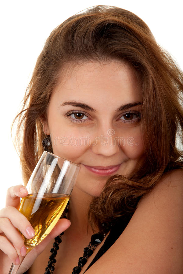 Woman with a glass of champagne. Beautiful woman with a glass with champagne on white background. Focus on woman's eyes royalty free stock images