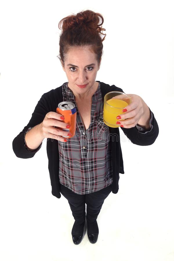Woman with a glass of orange soda on white background.  royalty free stock photography