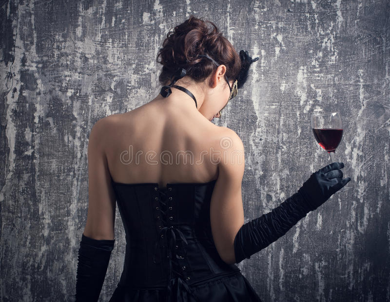Woman and a glass of red wine. royalty free stock photo