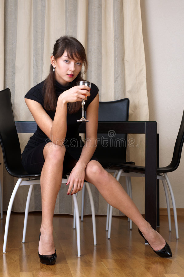 Woman with glass of red wine royalty free stock image